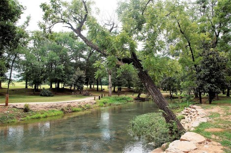 Orr Park on Shoal Creek features a natural setting along with the tree carvings of Tim Tingle. (Brittany Faush / Alabama NewsCenter)