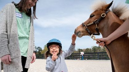The therapy horses at Storybook Farm have a positive effect on young visitors. The nonprofit is among the organizations that have received funding through the Alabama Power Foundation's Elevate grants program. (contributed)