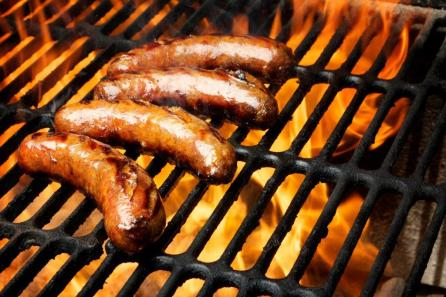Sausages need to cook in a liquid (beer works nice) before going on the grill. Otherwise they will burst open and cause flare ups. (Getty Images)