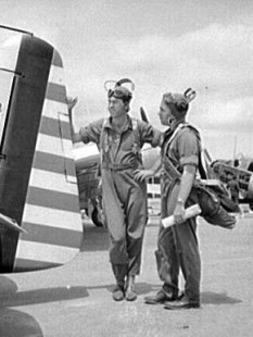 Flight instructors E.E. McTaggart, left, and J.C. Gumison converse before takeoff at the Craig Field Southeastern Air Training Center in Selma in August 1941. (From Encyclopedia of Alabama, Library of Congress, photograph by John Collier)