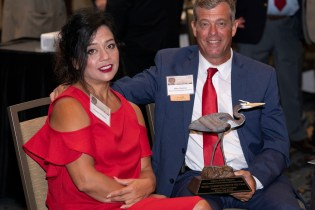 Suzanne and Mike Clelland with the Water Conservationist of the Year award. (Christopher Jones/Alabama NewsCenter)