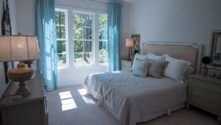 The master bedroom of the model home. (Dennis Washington / Alabama NewsCenter)