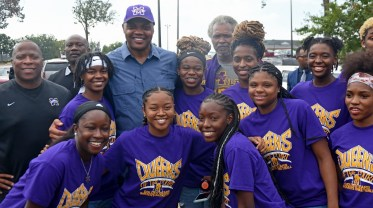 Basketball great Charles Barkley poses with members of the Miles women's basketball team. (Solomon Crenshaw Jr./Alabama NewsCenter)