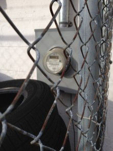 Fences, gates and items piled in front of electric meters frequently impede access for Alabama Power specialists. (contributed)