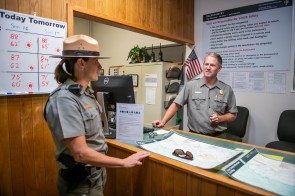 Chief Ranger Lisa Hendy chats with Park Ranger Nick Yarnell in the Great Smoky Mountains National Park's Wilderness Office, which provides visitors with information on backcountry traveling and camping. (Philip Smith)