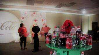 Birmingham-based Coca-Cola Bottling Company United launched two new holiday flavors with a holiday part at its corporate headquarters. Santa and Mrs. Claus joined the popular polar bear from Coke's commercials for the event. (Michael Tomberlin / Alabama NewsCenter)