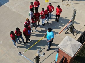 Alabama Power representatives give students an idea of what it's like to work on a power line during the Central Alabama Career Discovery Expo. (Alabama NewsCenter)