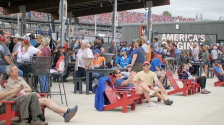 Fans watch the race from the comfort of the courtyard inside the new Talladega Garage Experience. (Dennis Washington / Alabama NewsCenter)