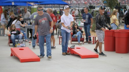 Fans play games in the courtyard of the new Talladega Garage Experience. (Dennis Washington / Alabama NewsCenter)