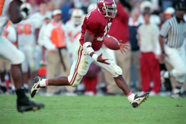 Shaun Alexander #37 of the Alabama Crimson Tide runs to catch the ball during the game against Tennessee Volunteers at the Bryant Denny Stadium in Tuscaloosa, Alabama. The Voulunteers defeated the Crimson Tide 21-7. (Elsa Hasch /Allsport)