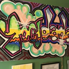 Why not create artwork with your own signature. A Yogi Dada personalized piece sits in her home studio. (Keisa Sharpe)