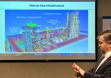 John Northington, Director of the National Carbon Capture Center, briefs U.S. Sens. Doug Jones and Joe Manchin. (Michael Sznajderman/Alabama NewsCenter)