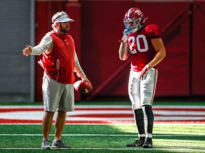 Alabama Defensive Coordinator/Inside Linebackers Coach Pete Golding works with DJ Douglas in preparation for the Vrbo Citrus Bowl. (Kent Gidley/University of Alabama Athletics)