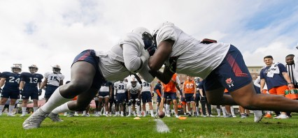 Auburn stars Marlon Davidson (3) and Derrick Brown (5) face off in drills in preparation for the Outback Bowl. (Todd Van Emst/AU Athletics)