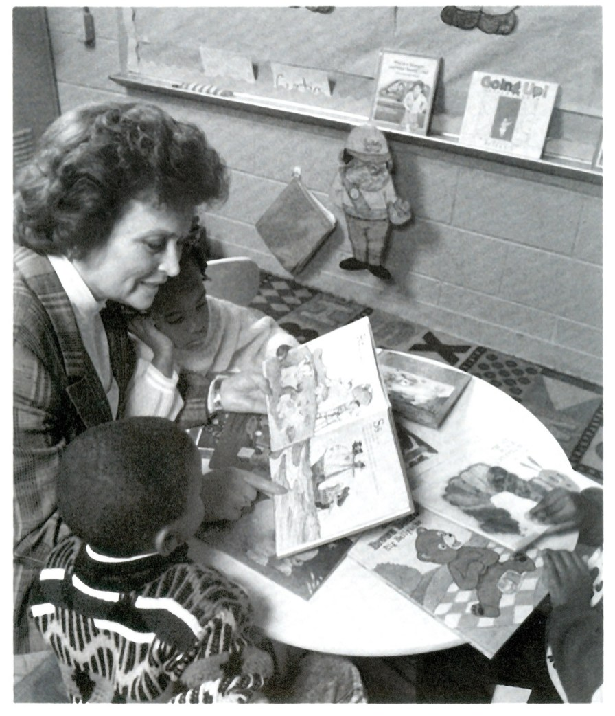 Volunteers read books to children enrolled in Head Start. The children got the keep the books. (Alabama Power Foundation)