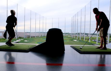 Guests enjoy playing at Topgolf in Nashville. (Anna Webber/Getty Images for CMT)