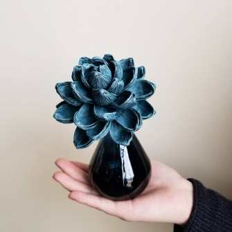 Thao Hoang used origami to bond with her middle school classmates when she arrived in Huntsville from Vietnam. Now she makes exquisitely detailed paper flowers for the business she co-owns with Anthony Ngo in Huntsville's Lowe Mill. (contributed)