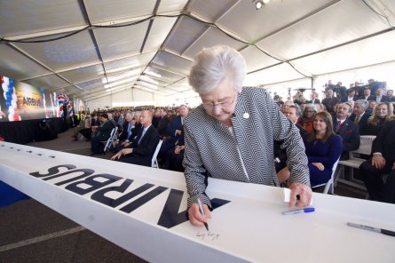 During a groundbreaking ceremony in January 2018, Alabama Gov. Kay Ivey signs a beam for the new Airbus A220 assembly line in Mobile. (Alabama Governor's Office)