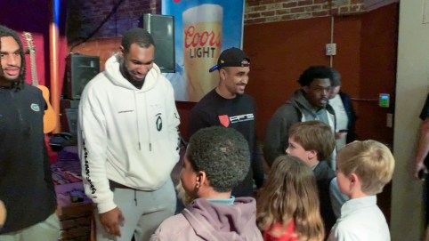 Former Alabama quarterback Jalen Hurts joins other Senior Bowl players in greeting kids at Thursday's fundraiser in downtown Mobile. (Dennis Washington / Alabama NewsCenter)
