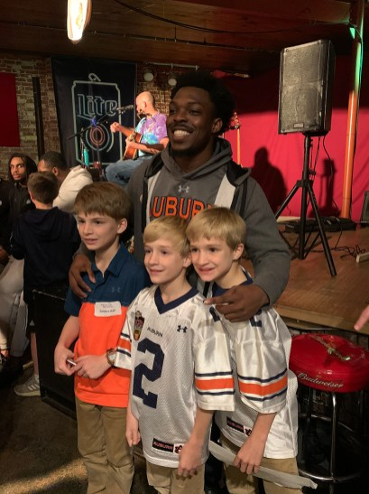 Auburn football defensive back Javaris Davis poses for pictures during Thursday's fundraiser. (Beth Thomas / Alabama NewsCenter)