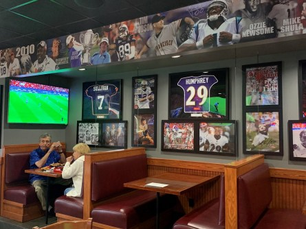Full Moon's decor has stuck to an Alabama sports theme throughout its history. (Susan Swagler/Alabama NewsCenter)