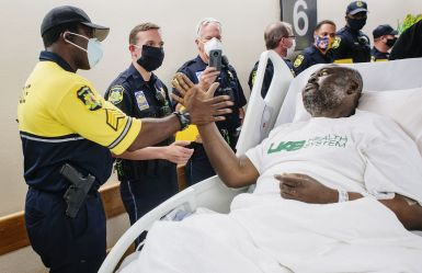 Guyton's co-workers are thrilled to see him on the road to recovery, after his 59-day stay for treatment. (Steve Wood/UAB)