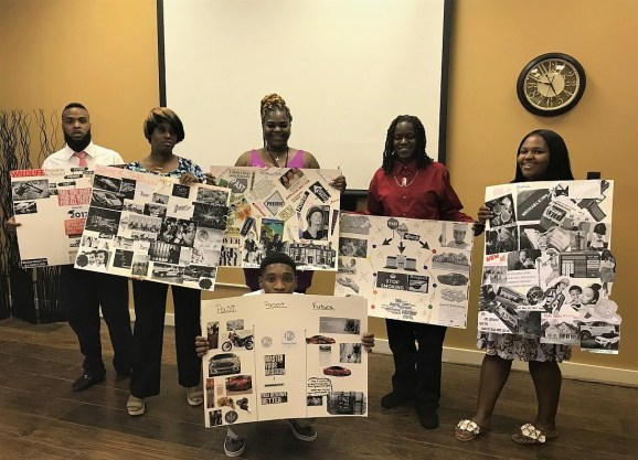 Participants show off their vision boards. (Dannon Project)