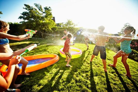 With a few small additions, your backyard can be a water park. (Getty Images)