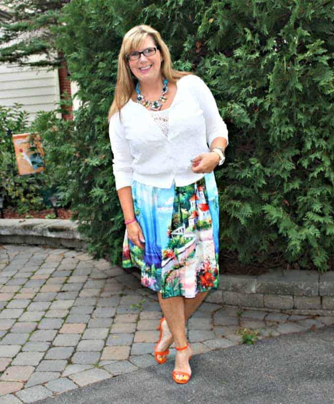 Orange Shoe Dazzle heels and a seascape skirt