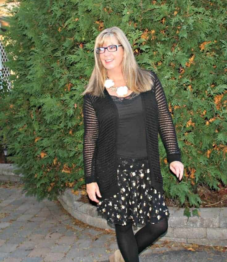 Open weave sweater and floral chiffon skirt, with konifer glasses and a happiness boutique necklace