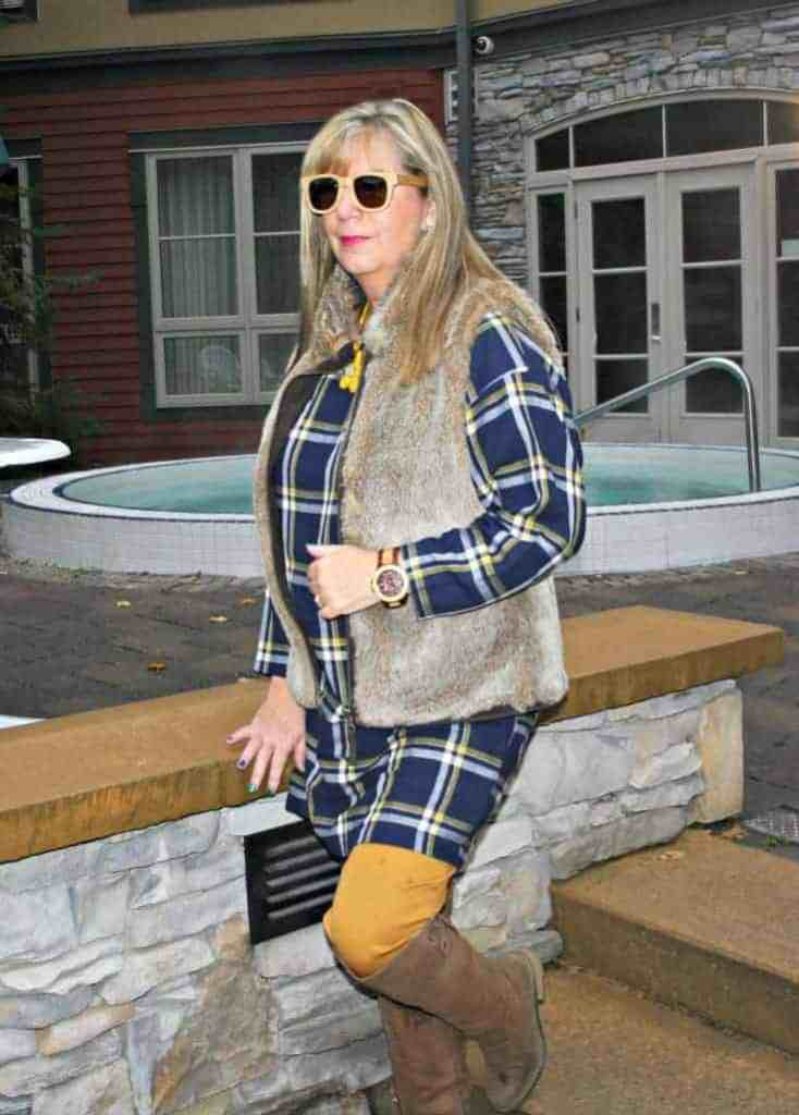 Old navy plaid tunic and pixie pants with a fur vest, jord watch and konifer sunglasses