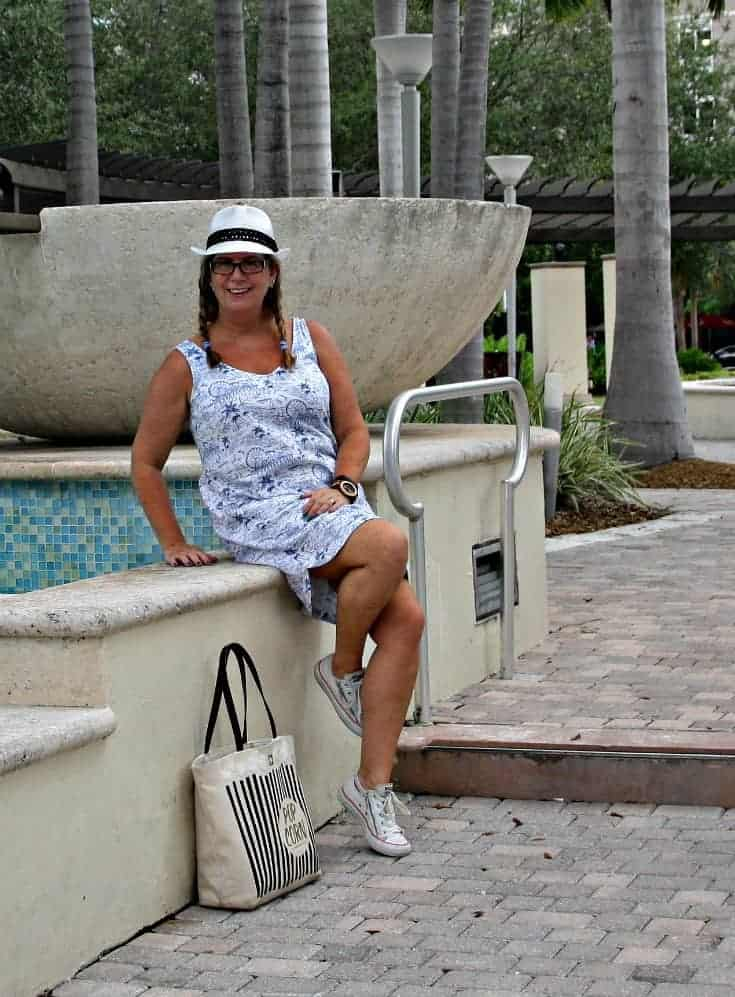 Fedora and Converse with Kate Spade Bag and a Jord Watch