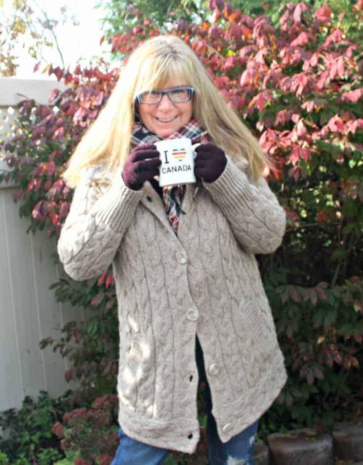 Hudson Bay Company sweater and plaid scarf with HBC mug