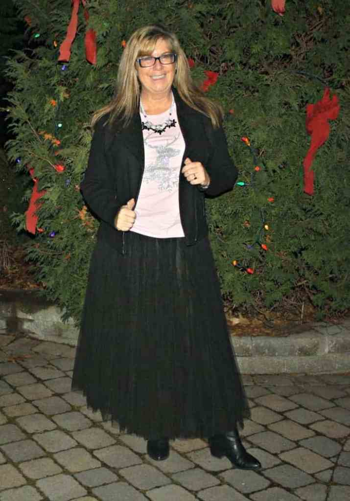 Glitter Reindeer shirt with a black tulle skirt and a moto jacket 11