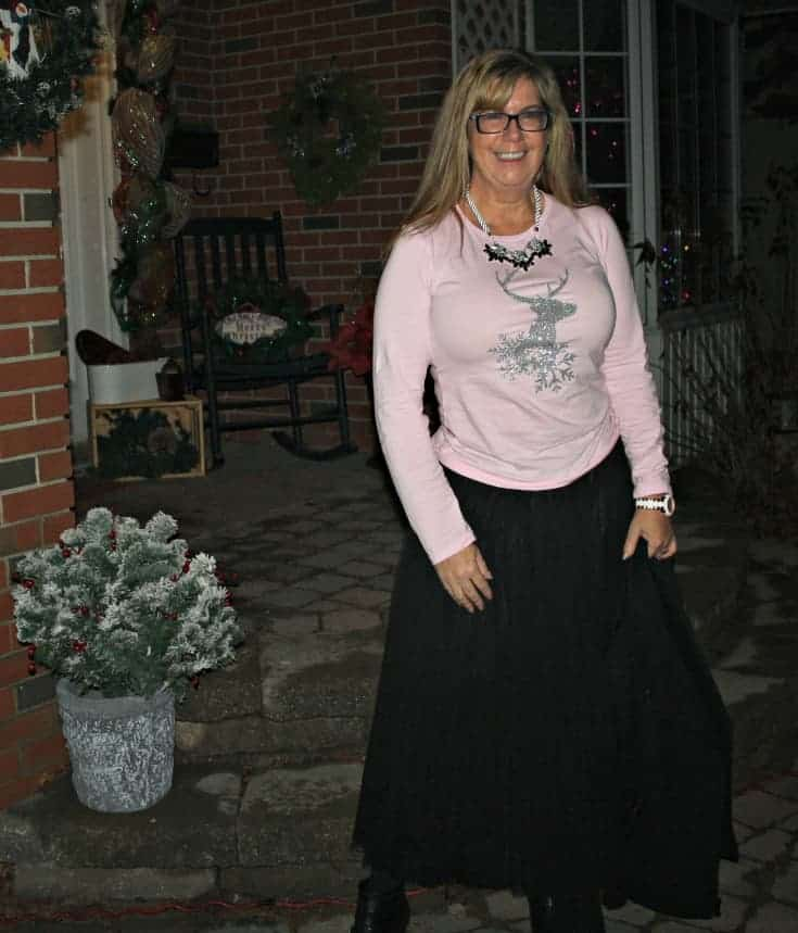 Glitter Reindeer shirt with a black tulle skirt and a moto jacket 14