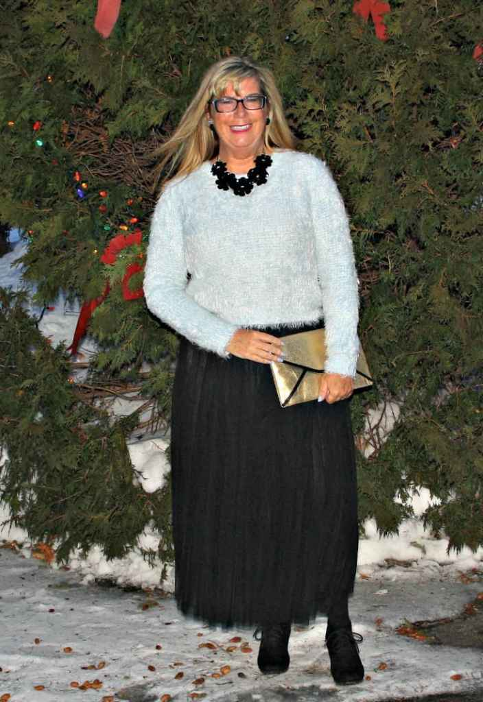 Shein Tulle skirt with a blue fuzzy sweater and floral necklace and gold clutch