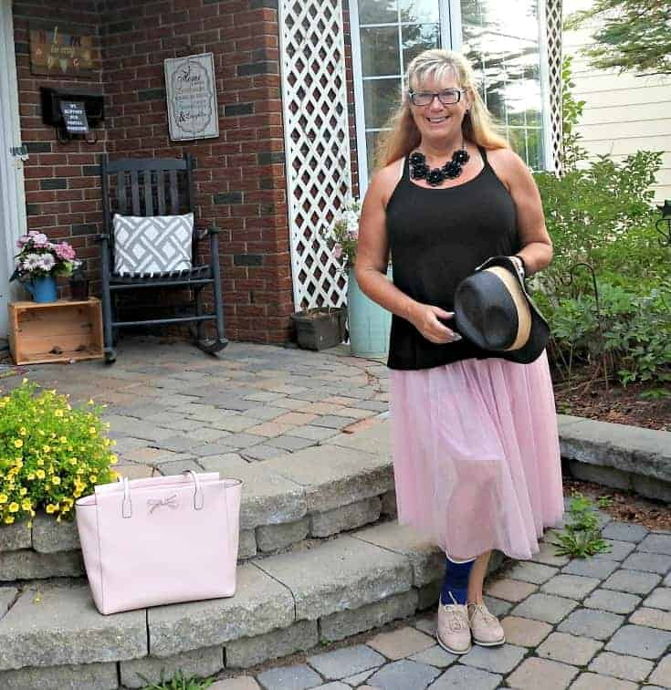 pink tulle skirt with pink oxfords and some edgy black accessories