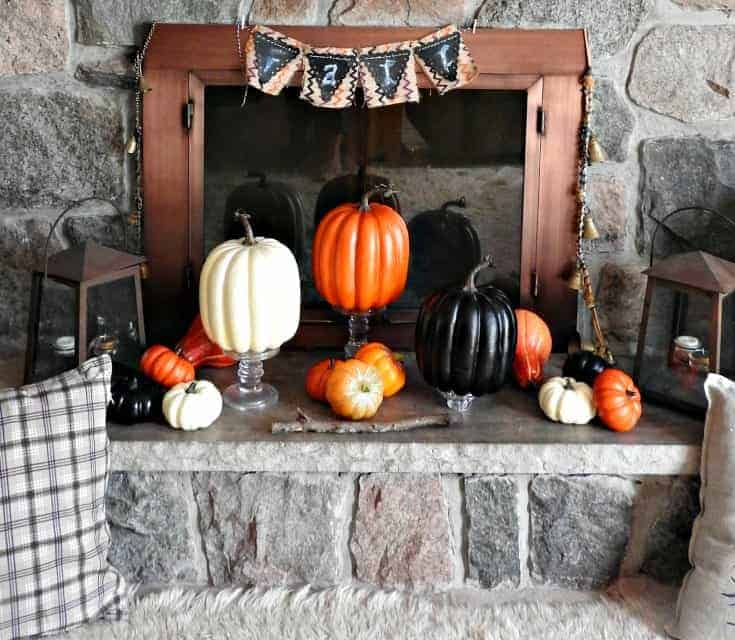 Fall decor for the mantle with a selection of pumpkins