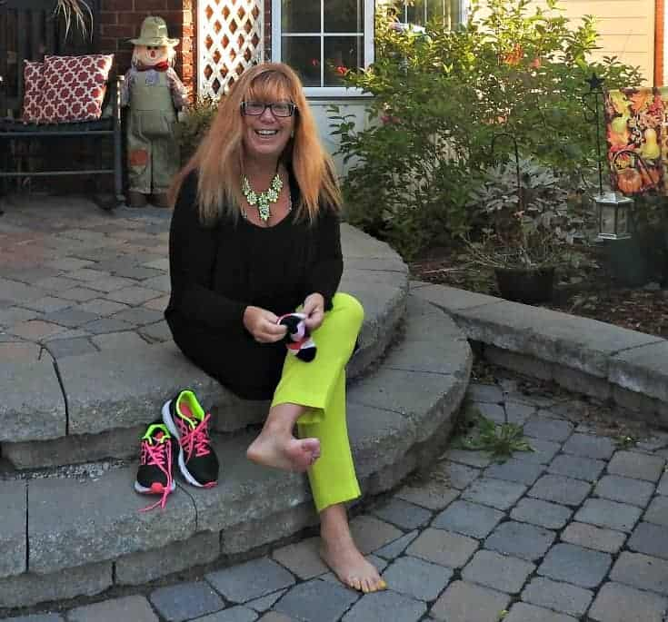 j crew neon pants, a fedora and neon nike sneakers and a Yosa necklace