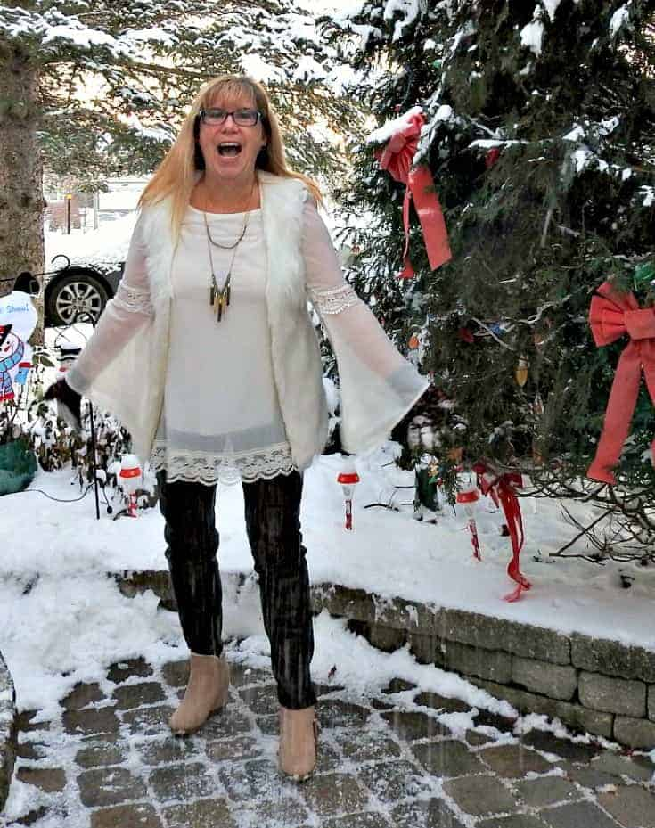 Tunic and white fur vest with a 7 charming sisters necklace, paired with leather leggings and my Lizdee wedges from Shoe Dazzle