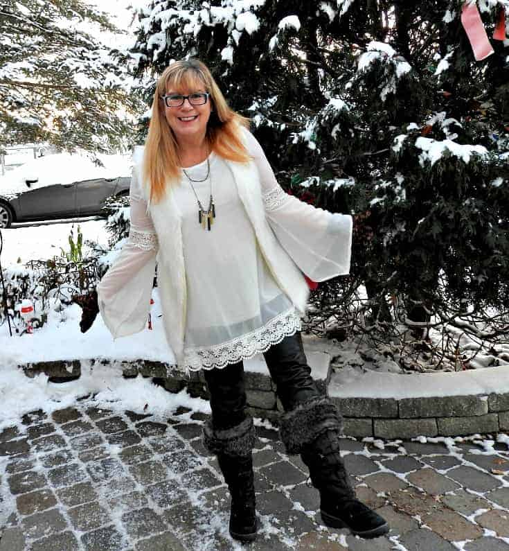 Tunic and white fur vest with a 7 charming sisters necklace, paired with leather leggings and my Cougar winter boot