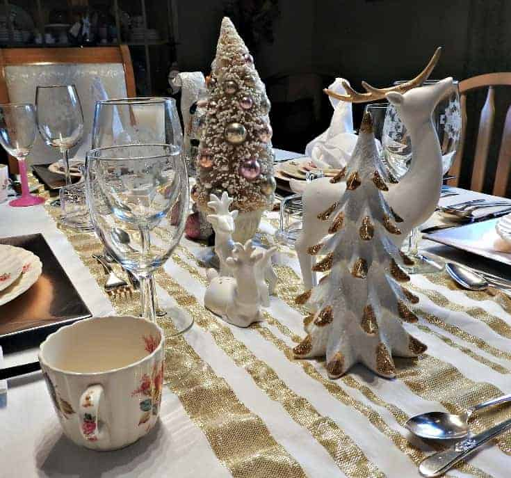 white and gold reindeer and tree