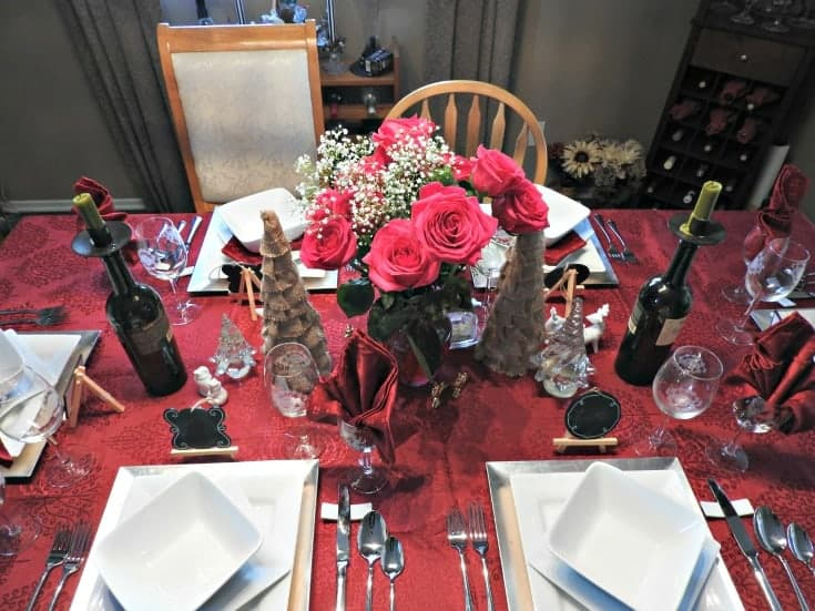 pink rose tablesetting with white china for a romantic dinner