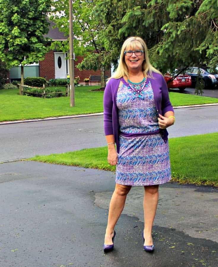 BR Purple and teal dress with matching cardi and a statement necklace from 7 Charming Sisters with a pair purple pumps