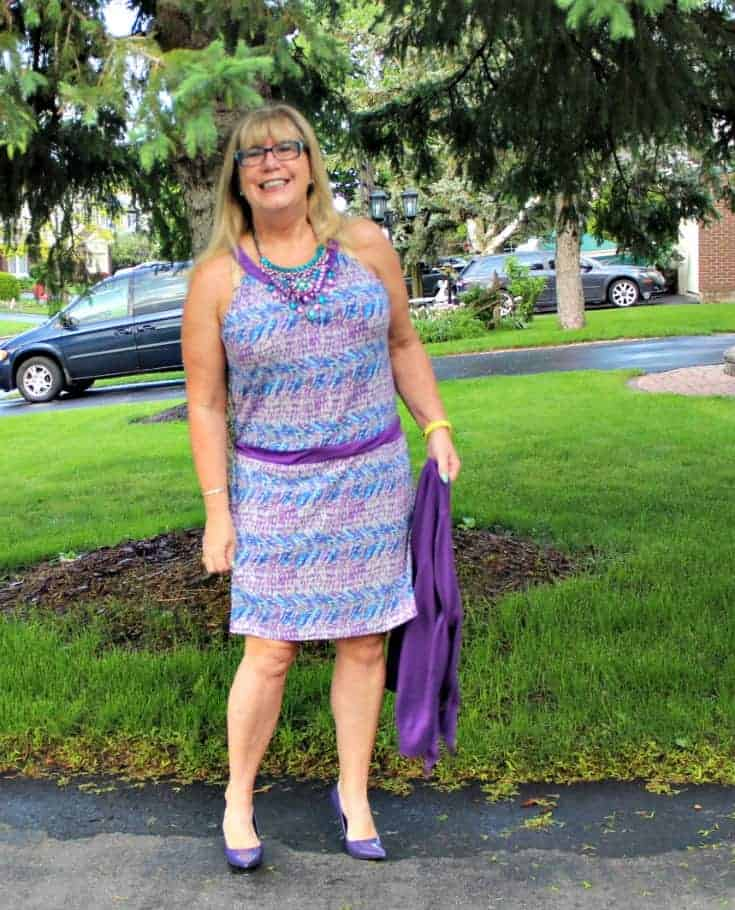 Purple and teal dress with matching cardi and a statement necklace from 7 Charming Sisters with a pair purple pumps 3
