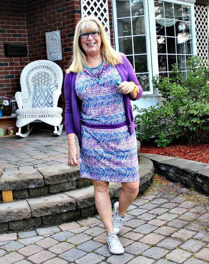 Purple and teal dress with matching cardi and a statement necklace from 7 Charming Sisters with a pair of converse