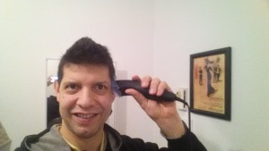 Alain cutting his own hair