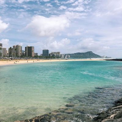 Photo of a sunny day at Ala Moana Beach Park - Magic Island Lagoon with Diamond Head in the background.