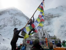 Raising Prayer Flags over Everest Base CampRaising Prayer Flags over Everest Base Camp