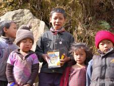 Passing out writing pens in the Khumbu.